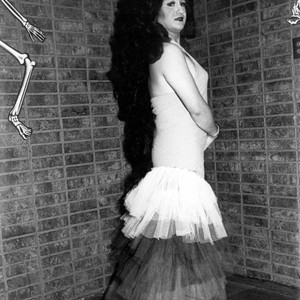 Female impersonator wearing a halter top dress