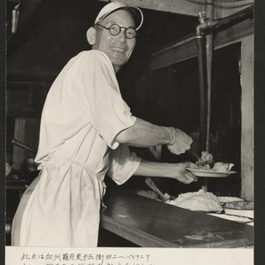 Shown is Mr. Yukio Suzuki, owner and operator of the Pioneer Cafe, ...