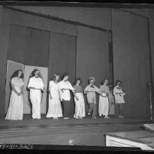 Eight teenagers performing a dance