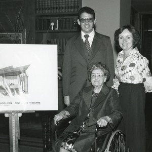 Mrs. Smothers seated in a wheel chair next to a sketch of ...