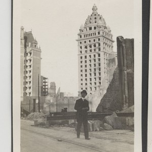 [Pedestrian in street. Geary St.? Call Building in background.]