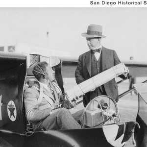 Frank M. Hawks seated in the glider Eaglet speaking with an unidentified ...