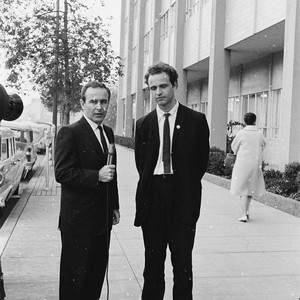 Mario Savio speaking with a reporter