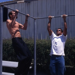 Henry T. Nicholas doing pull ups