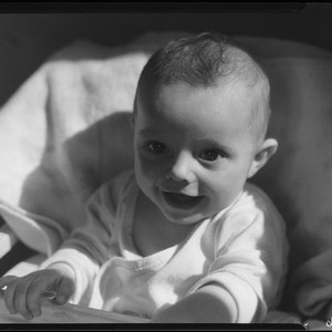 Baby in highchair, Los Angeles, circa 1935