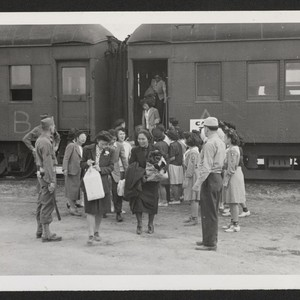 INCOMING--Arrivals leaving train assisted by Girl Scout with their baggage. Photographer: Aoyama, ...