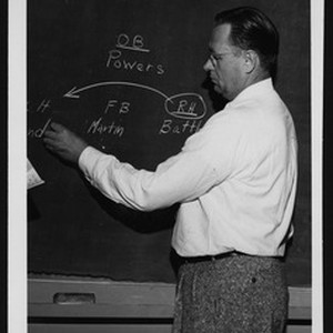 University of Southern California football coach Jeff Cravath diagramming a football play ...