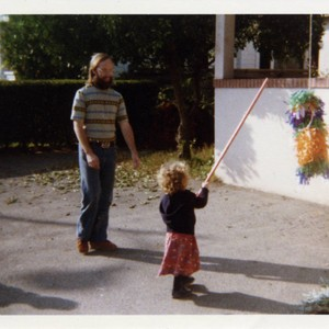 Little girl prepares to hit a pinata
