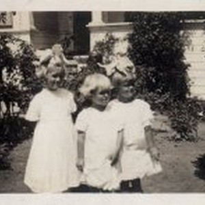 Three sisters with bows in their hair
