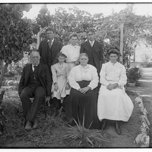 Family portrait in an orchard, Merced Falls, Merced County