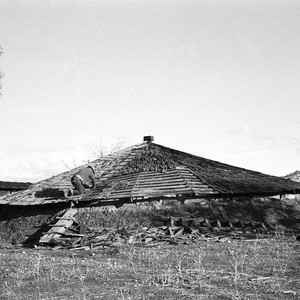 Wallace Burrows working on roof at Grindstone Round House