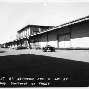 View shows the Southern Pacific Railroad's warehouses on Front Street