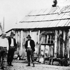 Three men in front of Shasta County homes