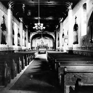 Long interior shot of Plaza Church showing pews, altar and side walls