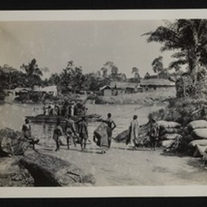 People crossing river by ferry, Ghana, 1926