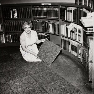 Banning Public Library Librarian, Dolores Smithpeter, during carpet installation in library