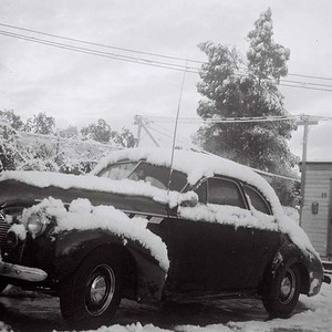 Snow on 1940s Car, at Top of Grevelia
