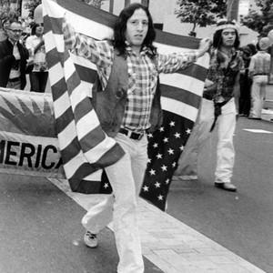 Calisphere: Parade participants carrying a