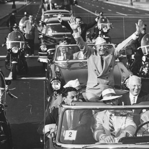 Eisenhower and Nixon ride in parade