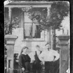 Unidentified two men, a woman
