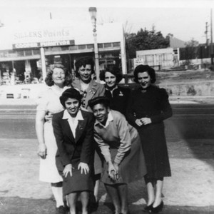 Women pose for photo on Temple Street