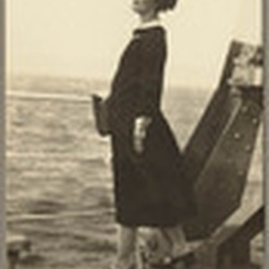 [Woman posing on deck next to railing, SS Admiral Farragut?]