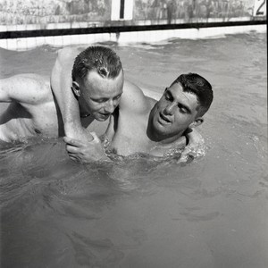 Two soldiers swimming in a pool