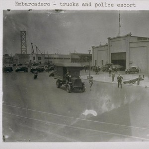 Embarcadero - trucks and police escort