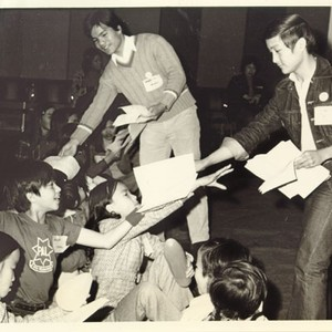 [Galileo High School students and Twin's Club members handing out songsheets at ...