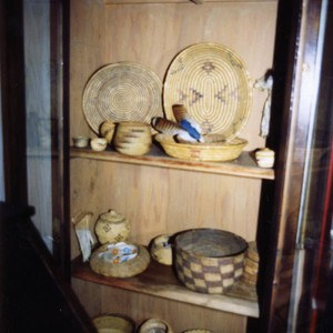 Baskets in display cabinet