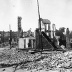[View of rubble and ruins along unidentified street]