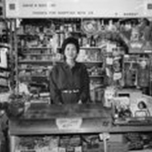 [Asian woman behind counter]