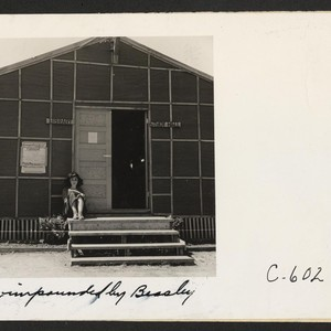 Tanforan Assembly Center, San Bruno, Calif.--Young evacuee on steps of the library ...