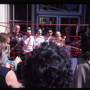 Demonstrators with red tape at a protest at San Francisco's Federal Building ...