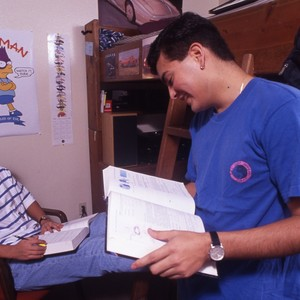 Mario Castillo (on the right), inside a dorm room, studying with another ...