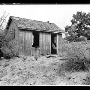 Exterior view of an old cabin in Dry Town, ca.1930