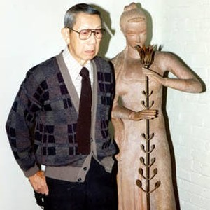 Gilbert Leong and a statue