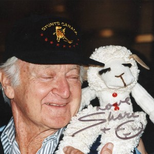 "Micky Moore with Lambchop on the set of ""Wrongfully Accused"" (1998)"