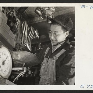 Joe Sitsuda weighs nails for a customer in the Union Hardware Store ...