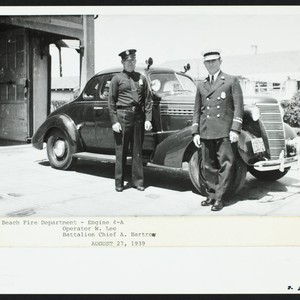 Operator W. Lee and Battalion Chief A. Bartron in front of Station ...
