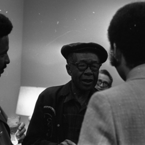 Jesse Fuller speaking with tv host and newsman Ray Taliaferro (right) and ...