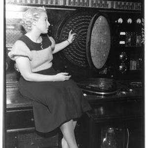 "Woman demonstrating the ""Spitz flight recorder"" at the United Airport in Burbank, ..."