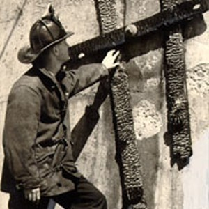 [Fireman inspecting a ladder that was burned in a fire on the ...