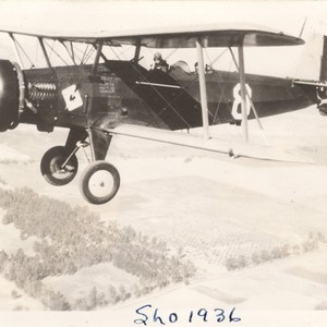 [Biplane over San Luis Obispo Co.]