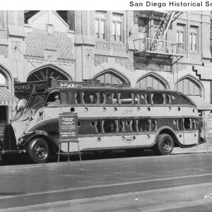 A double-decker bus parked in front of the Pickwick Hotel in downtown ...