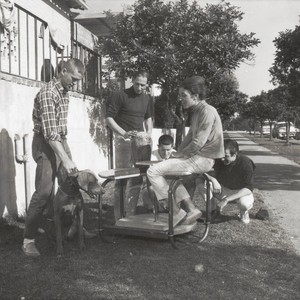Professor Soldner and students with pottery wheel, Scripps College