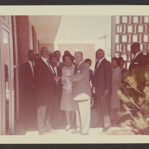 District Manager C.L. Smith with Edgar J. Johnson, Norman O. Houston, and ...