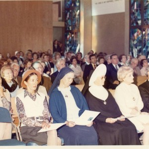 Mrs. Stauffer with her Chaplain and two nuns on the 1st Row