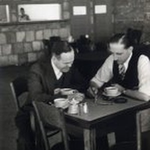Harold Elliott in discussion with another man, Motorola factory