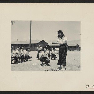 Manzanar, Calif.--Maye Noma behind the plate and Tomi Nagao at bat in ...